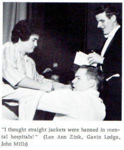 """""""Lee Ann Zink helps Gavin Lodge finish putting on his costume for the school play while John Mills gives his lines a final once-over."""""""